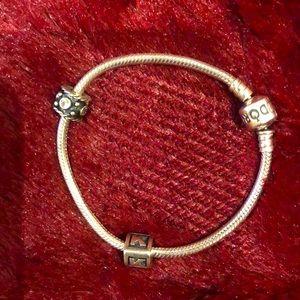 Authentic pandora bracelet with 2 charms. Size 7.1